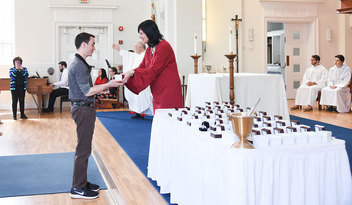 Male student receives his ring at ring blessing